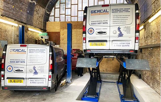 two vans on scissor lift - SASA Auto Repairs Install